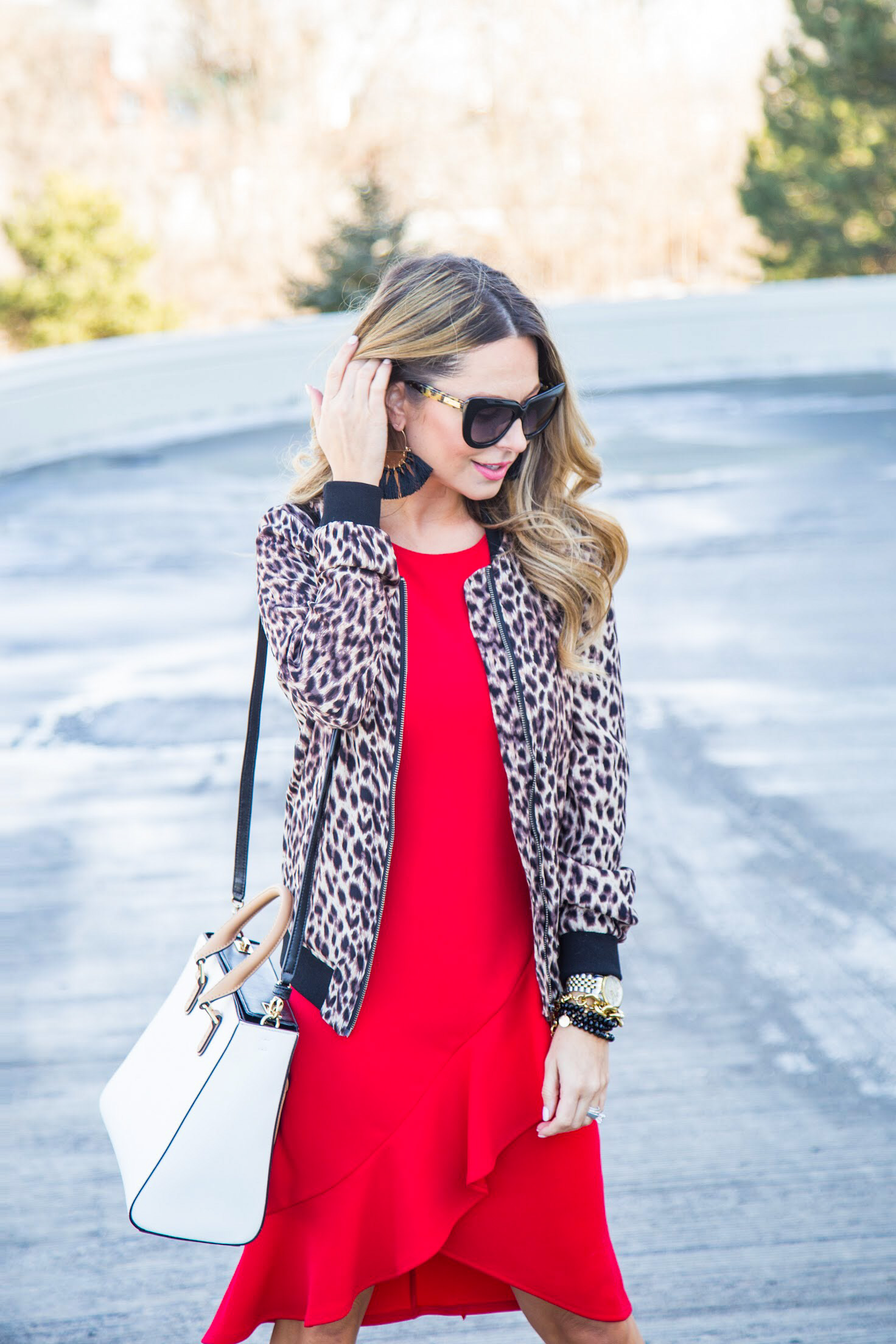 red dress from Gordmans with leopard bomber jacket with tassel earrings and cat eye sunglasses from Nordstrom