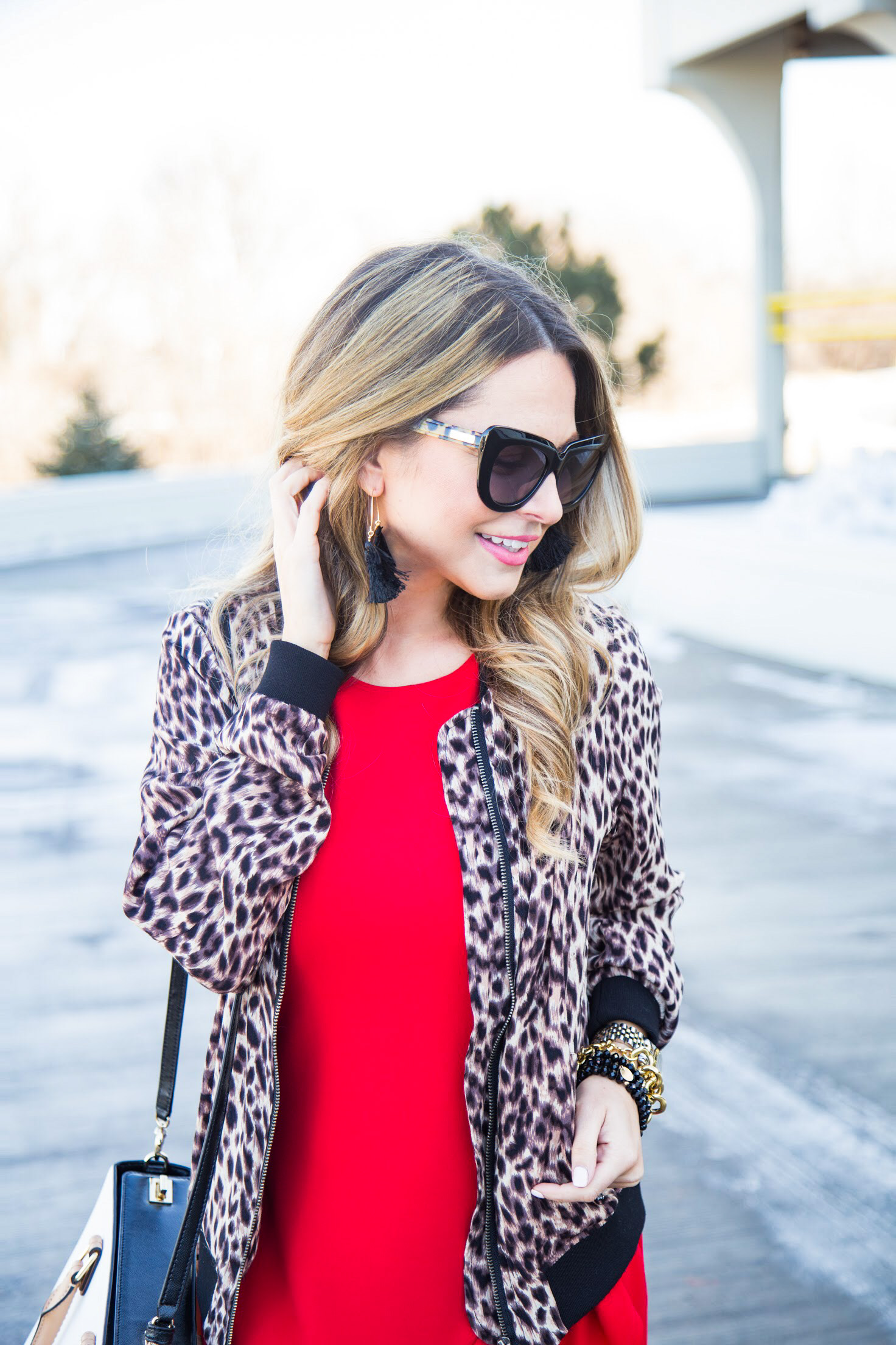 red dress from Gordmans with leopard bomber jacket and cat eye sunglasses