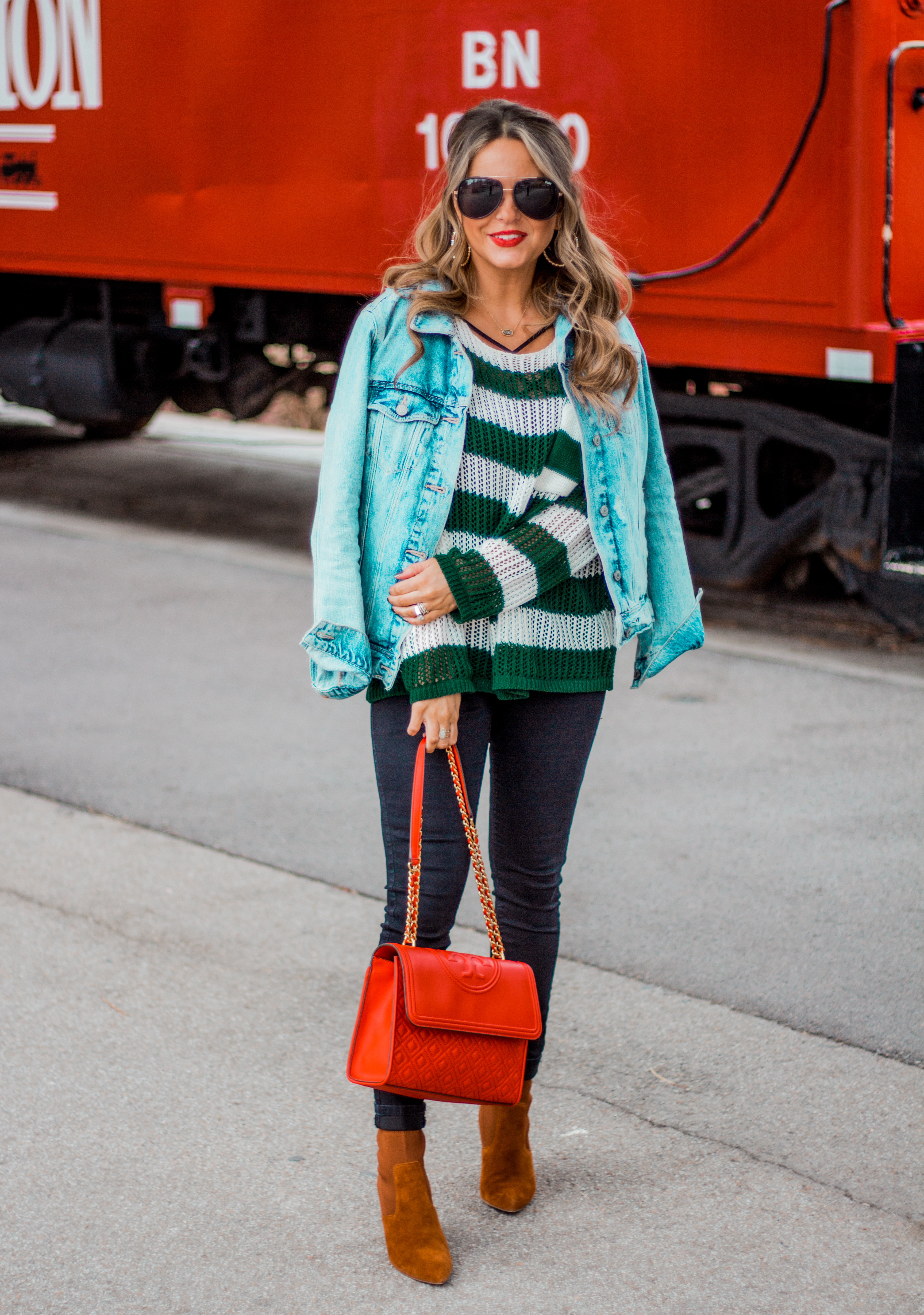 red quilted bag with black jeans